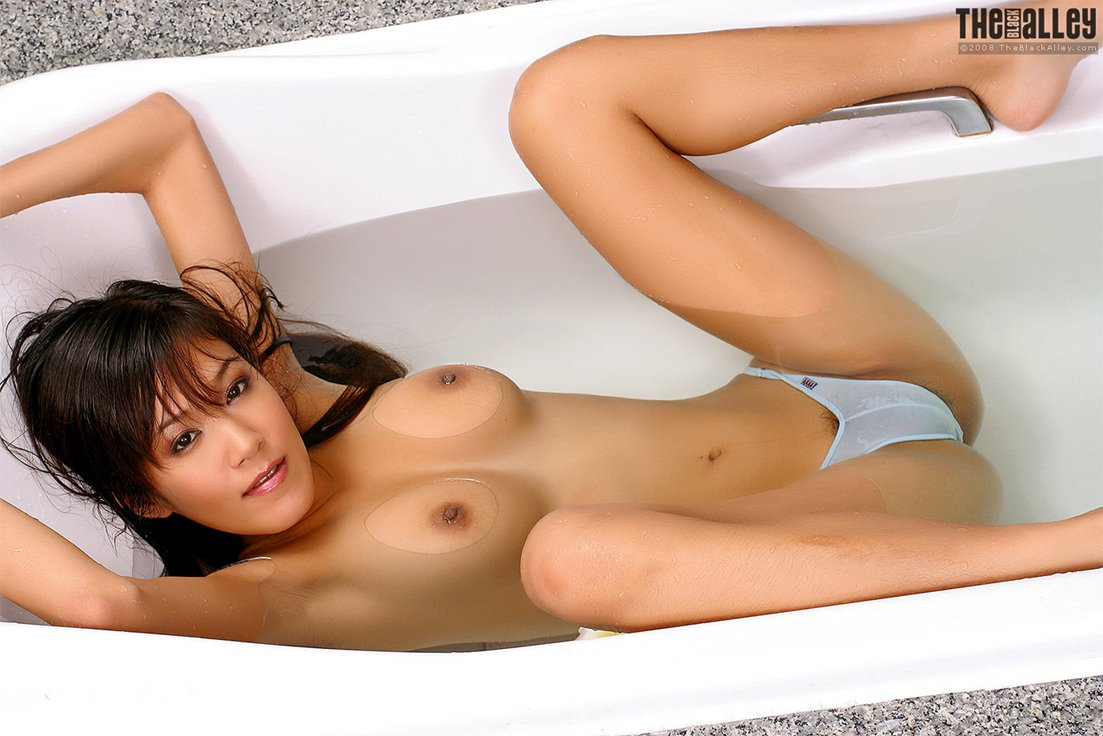 Busty asian girl in bathroom