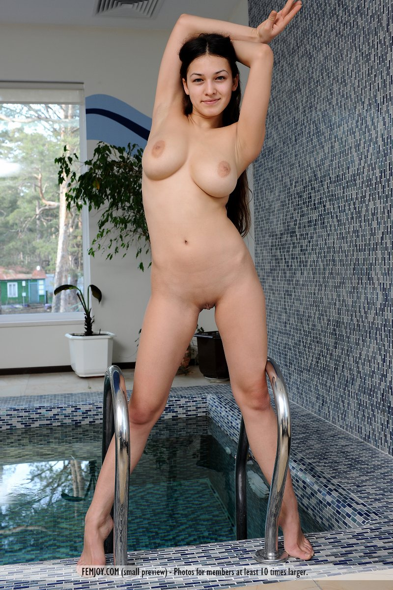 Nude girl swimming pool indoor