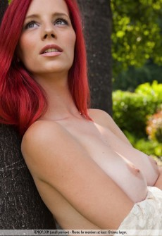 Busty Redhead Naked Under Trees