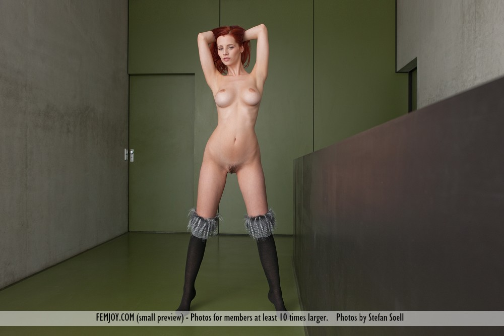 Casual beautiful redhead dancing nude