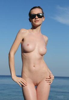 Nude Girl On Beach Wearing Sunglasses