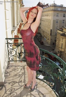 Sexy Redhead Model On Balcony